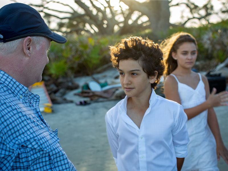 Director Michael Curtis on location on Jekyll Island filming Gift with principal actors Royce Mann who plays Aaron, and Katherine Shelper who plays Zoe. (Photo: Filmstigator)