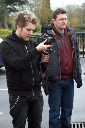 Brett Chapman shoots B-roll on Stop/Eject as Hadrian Cawthorne looks on.